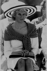 Princess Diana watches the festivities.