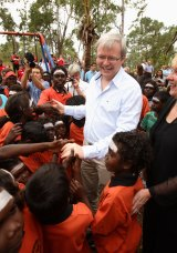 "Kevin Rudd, pictured at a school in the East Arnhem Land community of Yirrkala in 2008, has warned of new ""stolen generation""."