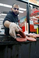 Hot item: Emad Salah cooks up a serving of camel burgers.