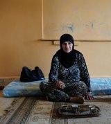Refugee Fatmeh, 60, in a school in Baalbek in Lebanon's Bekaa Valley.