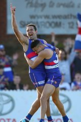 Happy days: Footscray's Brett Goodes (left) celebrates with Jason Johannisen during Saturday's preliminary final.