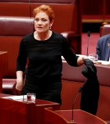 Senator Pauline Hanson pulls off the garment.