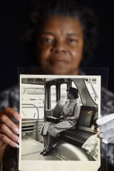 Maricia Battle, curator with the prints and photographs division of the Library of Congress, holds a photo of Rosa Parks from the exhibition.
