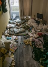 The crew took away Hiroaki's belongings, checked under the flooring, and scrubbed and disinfected the apartment.