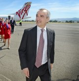 Virgin Australia chief John Borghetti believes a weaker dollar and increased competition on trans-Pacific routes will help to lure more American tourists to Australia.