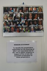The images of the 38 Australian victims killed on MH17 on the wall in the Australian embassy in The Hague, above the Australian Federal Police team's mission statement.