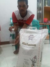 Fisherman Muhammad Hatta, who returned the asylum seekers to Indonesia, with rice and water  provided by Australian authorities.