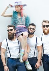 Kristine Walker in her own creation on the shoulders of the Bearded Bakers.