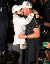 Kelly Landry and Anthony Bell embrace at Constitution Dock after he claimed line honours in the 2016 Sydney to Hobart Yacht Race.