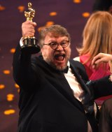Guillermo del Toro, winner of the Oscar for best director for <i>The Shape of Water</i>, celebrates in the audience.