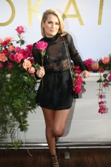 Keira Maguire hanging on to her rose at the Kookai launch.
