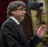 Carles Puigdemont stepped back from an immediate declaration of independence from Spain, instead seeking talks with the government in Madrid over the constitutional future of his region.