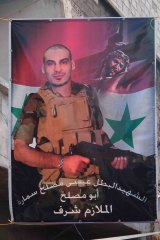 A banner in a Damascus street memorialises a Christian soldier killed while serving in the Syrian army.