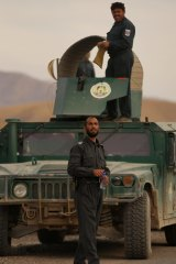 Matiullah Khan in front of his armoured Humvee on the Tarin Kowt to Kandahar highway. The former highway patrol officer charged trucks passing through his fiefdom for safe passage.