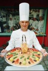 Bocuse introduces his culinary creation Coq de Bresse truffe G7 a la francaise in 1996.