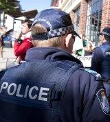Queensland Police monitor protestors.