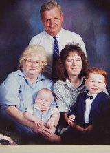 Daniel as a baby with grandparents Lynette and George, mother Suzanne and older brother Luke.