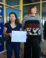 Maria Sevilla and Queensland Nurses Union secretary Beth Molle deliver the petition to Health Minister Peter Dutton's office.