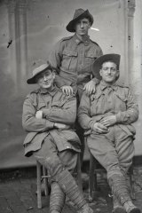 Three unidentified soldiers of the 1st Division.