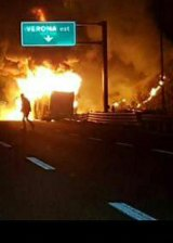 Flames engulf a bus that crashed near Verona, northern Italy.