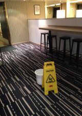 A bucket placed to contain water from a leak on board the Pacific Eden.