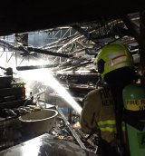 Firefighters at the Armidale Club fire. The site may become the pesticides authority's headquarters.