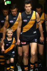 Trent Cotchin leads the Tigers onto the ground.