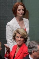 Gillard passes and Bishop in 2011.