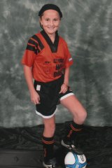 "Rae Anderson, posing for a soccer team photo, says people should be themselves and ""do what you want to do""."