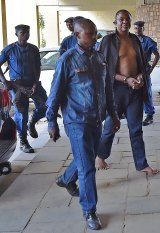General Niyungeko Juvenal, barefoot, arriving at the Supreme Court in Bujumbura on Saturday.