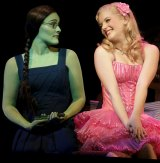 Jemma Rix as Elphaba and Lucy Durack as Glinda in <i>Wicked</i>.
