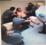 A CCTV still of security guards restraining Turkish national Mustafa Bektas at Maribyrnong detention centre.