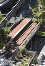 The former freight railway track being converted into a pedestrian and cycling connection linking Darling Harbour and Central was expected to open alongside the UTS business school this week.