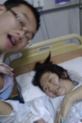 Liang Xuyang with wife Melinda Meng and their new baby.