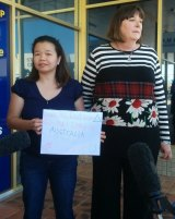Maria Sevilla and Queensland Nurses Union secretary Beth Molle deliver a petition to federal Health Minister Peter Dutton's office.
