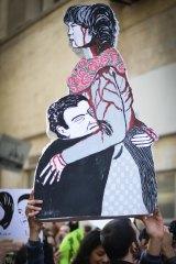 An Egyptian demonstrator holds a placard depicting Shaima al-Sabbagh.