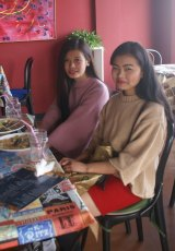 """It makes me hang my head in shame"": Neidonu Nuh, left, and a friend discuss women's rights in Nagaland at a Kohima cafe."