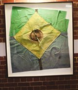 A framed piece of canvas from the first tent, sewn by Tim Coldwell and other early members.