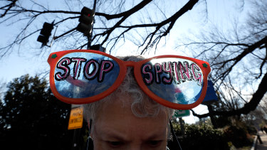 An activist protests the surveillance of US  citizens by the NSA outside the Justice Department  in Washington earlier this month.