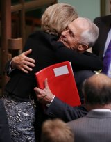 Malcolm Turnbull and Michaelia Cash hug after the ABCC victory.