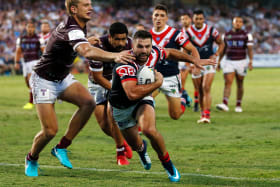 Off to a flyer: James Tedesco scored two tries on debut for the Roosters on Saturday night.