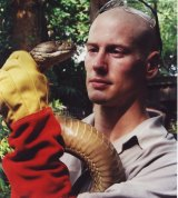 Bryan Fry holds a king cobra in Singapore.