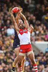Rising above it: Adam Goodes marks in front of Will Schofield on Sunday.