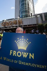 Unionists converged at Crown's flagship casino in Melbourne to protest job cuts.