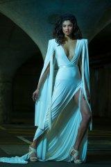 A model wears a floor length gown by Australian designer Jason Grech.