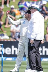 New Zealand captain Brendon McCullum expresses concern at the shape of the ball to umpire Steve Davis.
