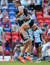 Valentine Holmes celebrates another try for the Sharks in Sunday's 62-0 flogging of the Knights at Hunter Stadium.