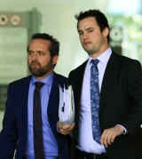 Defence lawyer Dennis Kinsella (left) and his associate leave the court.