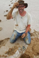 Phil Bland with the hole from which the meteorite was plucked.