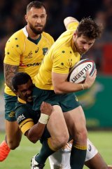 Bernard Foley is tackled by South Africa's Rudy Paige.